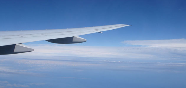 An image of an airplane wing, in flight
